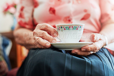 Buy stock photo Cropped shot of s senior woman having a cup of tea