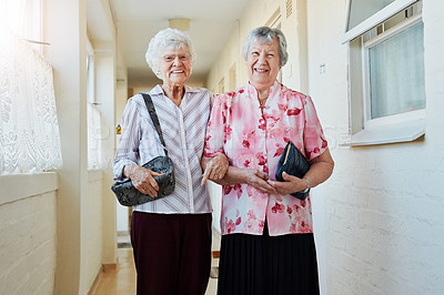 Buy stock photo Portrait of two happy elderly women carrying their bags and getting ready to go out