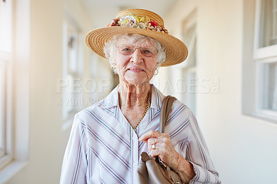 Buy stock photo Portrait of a happy elderly woman getting ready to go out