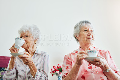 Buy stock photo Shot of two elderly women having tea together at home