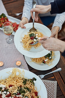 Buy stock photo Closeup shot of an unrecognizable woman dishing from a plate of pasta