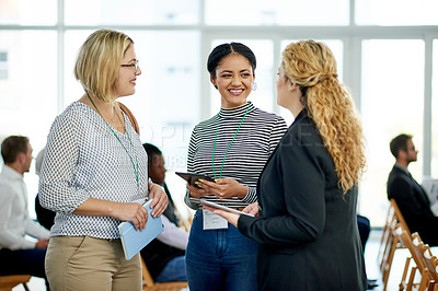 Buy stock photo Shot of a group of businesswomen having a discussion at a convention center