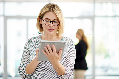 Buy stock photo Shot of a young businesswoman using a digital tablet at a convention center
