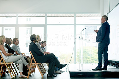 Buy stock photo Shot of a mature businessman delivering a presentation at a conference