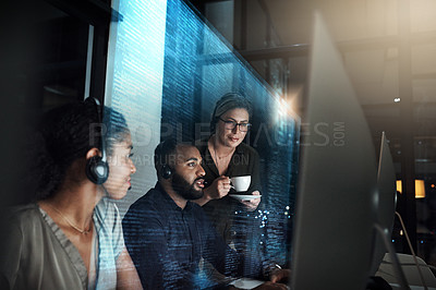 Buy stock photo Cropped shot of an IT support team working the late shift in their office