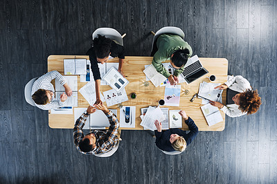 Buy stock photo High angle shot of a group of businesspeople celebrating during a meeting in an office