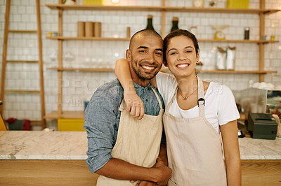 Buy stock photo Portrait of two young business owners and partners standing inside of their coffee shop during the day