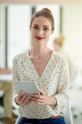 Buy stock photo Cropped shot of a young woman holding a digital tablet in an office