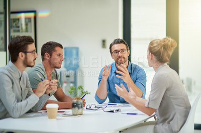 Buy stock photo Shot of a group of creative business colleagues in a meeting