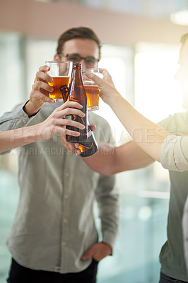 Buy stock photo Cropped shot of unrecognizable businesspeople toasting with beers