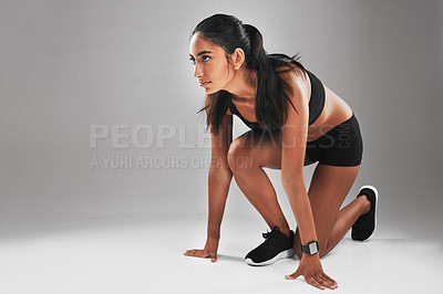 Buy stock photo Studio shot of a fit young woman against a gray background