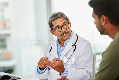 Buy stock photo Shot of a doctor having a consultation with a patient in his office