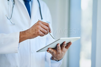 Buy stock photo Closeup shot of an unrecognizable doctor using a digital tablet in a hospital