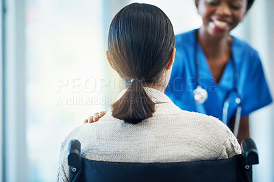Buy stock photo Shot of a female nurse consulting with a patient in a wheelchair