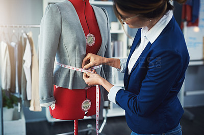 Buy stock photo Cropped shot of an attractive young fashion designer working on a mannequin in her design studio