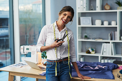 Buy stock photo Cropped portrait of an attractive young fashion designer holding a pair of scissors in her workshop