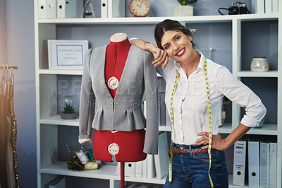 Buy stock photo Cropped portrait of an attractive young fashion designer working on a mannequin in her design studio