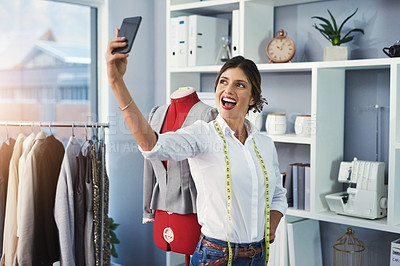 Buy stock photo Cropped shot of an attractive young fashion designer taking selfies while working in her design studio