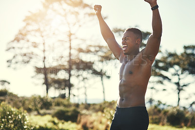 Buy stock photo Cropped shot of a handsome young man standing with his hands raised while exercising outdoors
