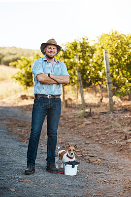 Buy stock photo Portrait of a farmer and his dog standing in a vineyard