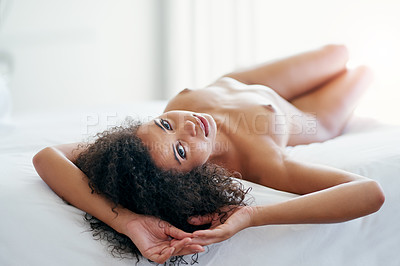 Buy stock photo Shot of a beautiful young woman completely nude on her bed