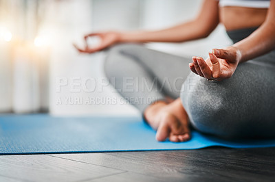 Buy stock photo Cropped shot of an unrecognizable woman doing yoga