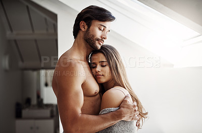 Buy stock photo Cropped shot of an affectionate young couple in their bedroom at home