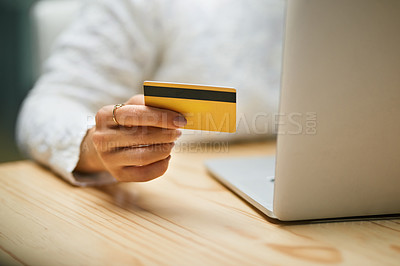 Buy stock photo Closeup shot of an unrecognizable woman using a credit card and laptop