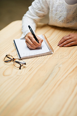 Buy stock photo Closeup shot of an unrecognizable woman writing in a notepad