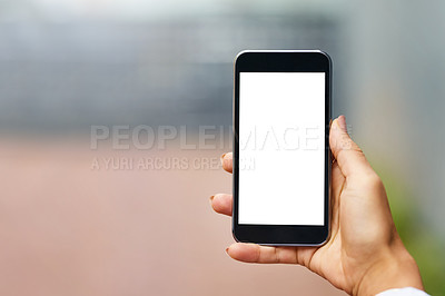 Buy stock photo Closeup shot of an unrecognizable woman holding a cellphone with a blank screen