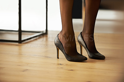 Nothing says sexy like black leather high heels