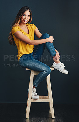 Buy stock photo Studio shot of an attractive young woman against a dark background