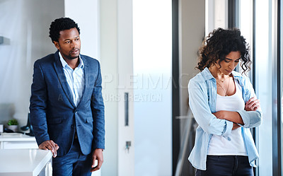 Buy stock photo Cropped shot of a young married couple arguing at home