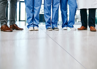Buy stock photo Closeup shot of a group of medical practitioners standing in a hospital