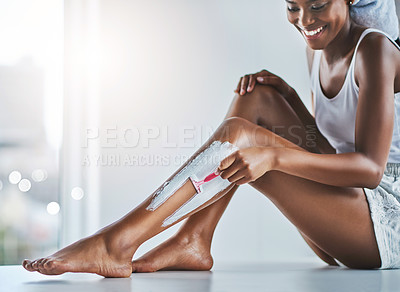 Buy stock photo Shot of an unrecognizable woman shaving her legs