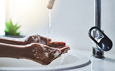 Buy stock photo Cropped shot of a woman washing her hands at a sink
