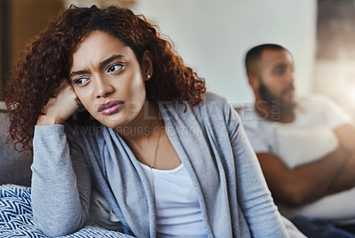 Buy stock photo Cropped shot of a young woman looking upset after having an argument with her boyfriend