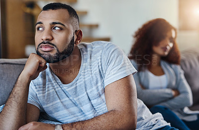 Buy stock photo Shot of a couple having a disagreement at home