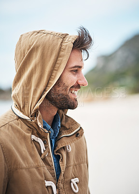 Buy stock photo Cropped shot of a handsome young man on the beach