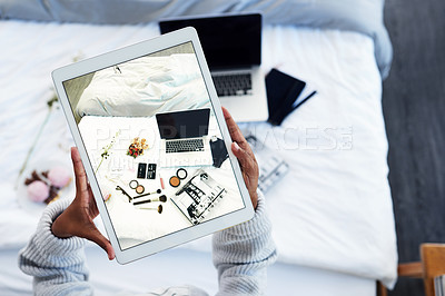 Buy stock photo High angle shot of an unrecognizable woman sitting at home