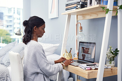 Buy stock photo Cropped shot of an attractive young woman working at home