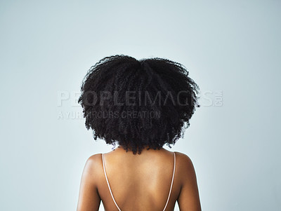 Buy stock photo Rearview studio shot of a young woman with curly hair