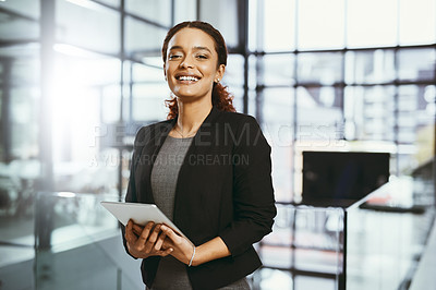 Buy stock photo Portrait of a confident young businesswoman holding a digital tablet in a modern office