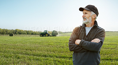 Buy stock photo Shot of a mature farmer standing on a field
