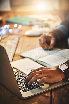 Buy stock photo Cropped shot of a businessman using a laptop during a late night at work