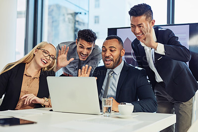 Buy stock photo Shot of a group of young businesspeople using a laptop to make a video call during a boardroom meeting