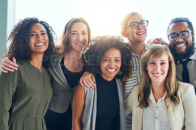 Buy stock photo Cropped portrait of a group of young businesspeople standing together in their office