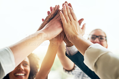 Buy stock photo Cropped shot of a group of businesspeople joining their hands in unity