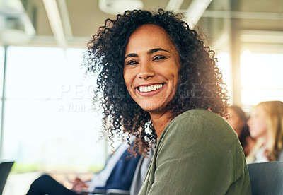 Buy stock photo Cropped portrait of an attractive young businesswoman sitting in a conference room during a seminar