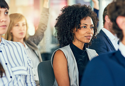 Buy stock photo Cropped shot of an attractive young businesswoman sitting in a conference room during a seminar